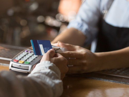 Female Customer Holding Credit Card Near Nfc Technology On Counter